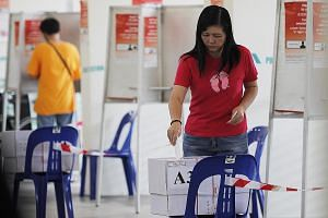 A voter at a polling station during the 2011 presidential election. Mr Shanmugam notes that while there is no ideal way of choosing the best person for the role of president, the changes to the eligibility criteria could be seen as markers for findin