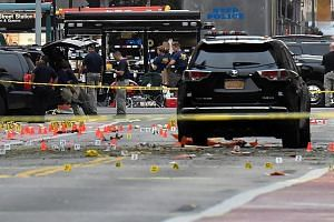 """Emergency workers at the scene of the explosion in New York City on Saturday night. New York Governor Andrew Cuomo has called the powerful explosion that injured 29 people """"an act of terrorism"""", but said no link to international groups had been found"""