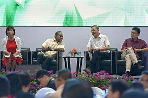 (From left) Central Singapore District Mayor Denise Phua, Mr Shanmugam, Minister of State Sam Tan and Minister of State Chee Hong Tat at a dialogue with grassroots leaders and residents at ITE College Central yesterday. The Government is updating the