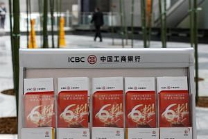 Industrial and Commercial Bank of China (ICBC)'s leaflets are displayed at its branch in Beijing, China, on March 30, 2016.