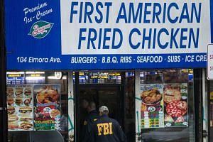 FBI investigators outside the fried chicken restaurant  business and home of family members of Ahmad Khan Rahami in Elizabeth, New Jersey on Monday (Sept. 19).