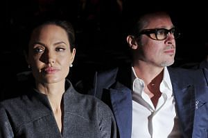 Angelina Jolie and Brad Pitt at the Global Summit to End Sexual Violence in Conflict at the Excel Center in London on June 13, 2014.