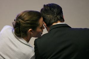 Angelina Jolie whispers to Brad Pitt during the World Economic Forum in Davos, Switzerland, on Jan 26, 2006.