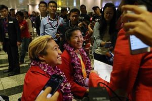 (From left) Paralympic medallists Theresa Goh and Yip Pin Xiu speaking to the media at Changi Airport after their return from Rio yesterday morning. On Saturday, a celebratory parade will mark the achievements of all 13 athletes who represented Singa