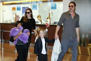 Brad Pitt and Angelina Jolie arrive in Tokyo on July 28, 2013, with their children Pax, Shiloh and Knox.