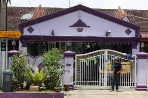Malaysian police arrested eight men in connection with the murder of a woman and her daughter in a house (pictured) in Johor's Taman Puteri Wangsa.
