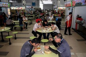 People eating at the hawker centre at Ci Yuan Community Club.