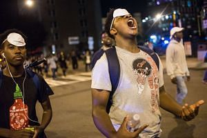 A demonstrator shouts as residents and activists protest the death of Keith Scott on Sept 22, 2016 in Charlotte, North Carolina.