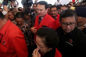 Ahok (centre) with his running mate, Mr Djarot (behind him), and former president Megawati Sukarnoputri (in front) at Jakarta's General Election Commission on Wednesday.
