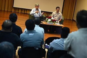 Dr Yaacob (left) and Mr Zainal at the dialogue with unionists at Mendaki's premises in Siglap yesterday. Dr Yaacob said it was important to ensure the presidency is held by people from all the major races from time to time as the president is a symbo