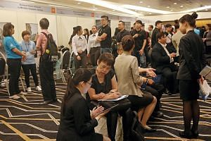 Job seekers at the hotel career fair yesterday. The hotel sector, which employs 35,000 people, has about 2,100 vacancies, of which 40 per cent are for PMETs.