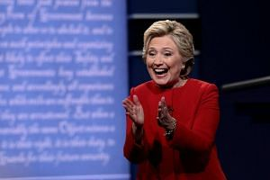 Democratic presidential nominee Hillary Clinton reacts after the first presidential debate.