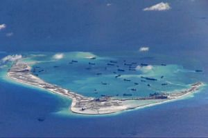 In a handout photo provided by the US military, Chinese dredging vessels are purportedly seen in the waters around Mischief Reef in the disputed Spratly Islands in the South China Sea on May 21 last year. The Global Times article, citing sources, said tha