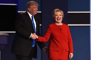 Republican presidential nominee Donald Trump and Democratic presidential nominee Hillary Clinton shake hands at the first US Presidential Debate at Hofstra University on Sept 26, 2016.