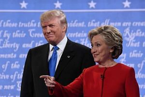 Hillary Clinton and Donald Trump stand next to each other before their presidential debate.