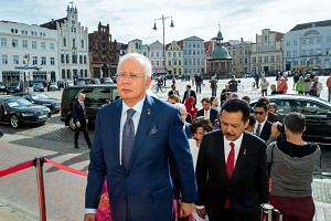Malaysian Prime Minister Najib Razak has said that he will call for a meeting with the Netherlands and Australia to decide on their next course of action regarding the crash.