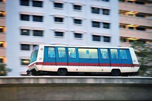 A Light Rapid Transit (LRT) train travelling along the Bukit Panjang LRT line.