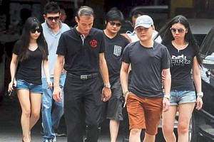 Family members and friends arriving at the hospital mortuary in Kuala Lumpur.