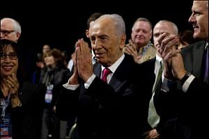 Mr Shimon Peres reacting after US President Barack Obama announced he would award him the Presidential Medal of Freedom during his address at the Aipac Policy Conference in Washington on March 4, 2012.