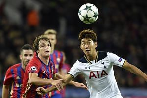 Tottenham Hotspur's Son Heung Min (right) vies for the ball in his team's Champions League match against CSKA Moscow.