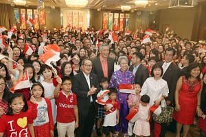 Prime Minister Lee Hsien Loong and Mrs Lee take a group photo with Mr Chin Siat Yoon (centre left) and Singaporeans residing in Japan during a National Day reception at Palace Hotel on Sept 27, 2016.