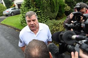 Former England national football team manager Sam Allardyce faces the press outside his home on Sept 28.