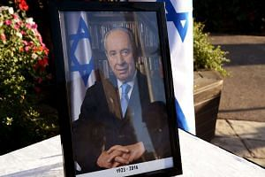 A framed portrait of former Israeli president and Nobel Peace Prize winner Shimon Peres displayed outside the presidential compound in Jerusalem, on Sept 28.