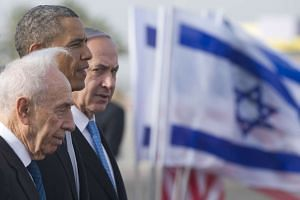 Obama (centre) stands alongside Israeli Prime Minister Benjamin Netanyahu (right) and late Israeli president Shimon Peres in this 2013 file photo.
