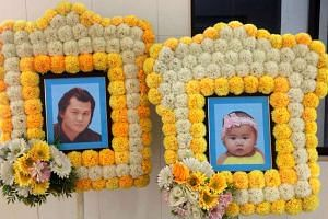 The photographs of seven-month-old Cheah Kai Wen and her father, Mr Cheah Hing Soon at the funeral. They were found dead in a Kuala Lumpur apartment on Sept 26, 2016.