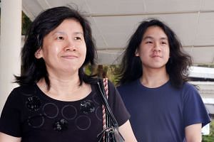 Teen blogger Amos Yee arrives with his mother at the State Courts in Singapore on Sept 28, 2016.