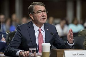 Carter (above, in a file photo) said the US would reaffirm its commitment to strengthen cooperation on the shared security challenges in the region.