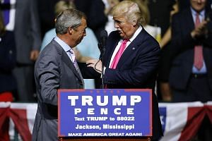 Mr Trump (at right) with Mr Farage at a campaign rally. The former Ukip leader is also expected to assist Mr Trump in the build-up to the third and final presidential debate on Oct 19.