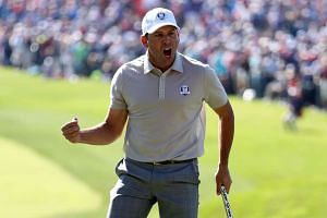 Sergio Garcia of Europe reacts to a putt on the 16th green during morning foursome matches.