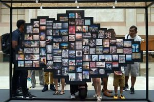 A hundred Instagram photographs of Singapore, ranging from its people, landscape, food and culture are on display at a photo exhibition launched on Saturday (Oct 1).