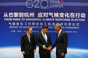 Chinese President Xi Jinping (centre), US President Barack Obama (right) and UN Secretary General Ban Ki-moon shake hands during a joint ratification of the Paris climate change agreement ceremony ahead of the G20 Summit at the West Lake State Guest