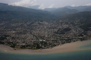 An aerial view as Hurricane Matthew approaches in Port-au-Prince, Haiti. The storm has claimed its first victims.