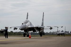 Indonesian Air Force Sukhoi fighter jets land after training for an upcoming military exercise at Hang Nadim Airport, Batam, Riau Islands, Indonesia on Oct 3, 2016.