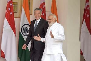Mr Lee and Mr Modi at Hyderabad House in New Delhi yesterday. PM Lee is in India on a five-day working visit. During their meeting, the two leaders agreed to appoint senior ministers to facilitate investment flows and deepen financial cooperation bet