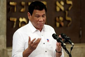 Philippine President Rodrigo Duterte gesturing during his speech at the Beit Yaacov Synagogue, The Jewish Association of the Philippines in Makati city, metro Manila, Philippines, on Oct 4, 2016.