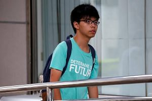 Activist Joshua Wong walking to a court before a verdict on charges of inciting and participating in an illegal assembly in 2014 which led to the 'Occupy Central' pro-democracy movement in Hong Kong, on Aug 15, 2016.