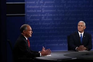 Mr Tim Kaine (left), the 2016 Democratic vice-presidential nominee, speaking during his debate against Mr Mike Pence, his Republican counterpart.