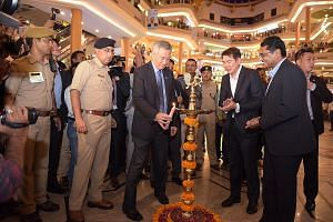 PM Lee at a light-up ceremony at Celebration Mall in Udaipur, India, yesterday. With him are CapitaLand group chief executive Lim Ming Yan (second from right) and CapitaLand Malls Asia's India country head B.V. Bharadwaja (right). CapitaLand yesterda