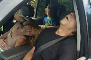 Photos of the couple allegedly passed out in their car on heroin with their child in the back seat were posted on Facebook by the police.