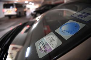 A Park & Ride disc displayed on the windshield of a car at the carpark at Block 156A in Toa Payoh Lorong 1 yesterday.