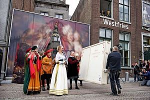 Employees carry a box containing stolen paintings during a ceremony to celebrate their return in Hoorn, The Netherlands, Oct 7, 2016.