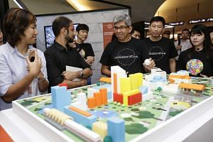 Minister for Communications and Information Dr Yaacob Ibrahim (centre) and Minister of State for Ministry of Communications and Information Chee Hong Tat (second from left) touring the exhibitions during the launch of GovTech on Oct 7, 2016.