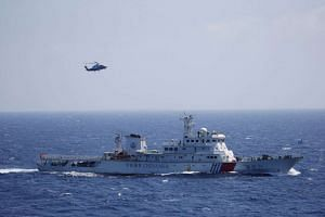 A Chinese ship and helicopter during an exercise in the Paracel Islands. China had pledged to finalise the framework for the Code of Conduct on the South China Sea by the middle of next year, but it remains to be seen whether this will translate into tang