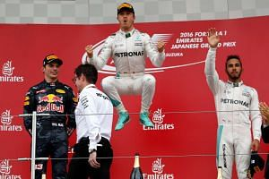 Nico Rosberg celebrating on the podium next to Max Verstappen (left) and Lewis Hamilton, at the Japanese Grand Prix in Suzuka on Oct 9, 2016.