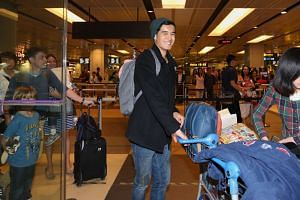 Singer Nathan Hartono arrives home at Changi Airport Terminal 1 on Oct 9, 2016. Hartono has been in Beijing competing in the Sing!China comepetition and came in second in the finals.