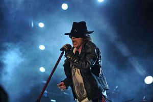 Axl Rose of Guns N' Roses performing during a concert in Bangalore on Dec 7, 2012.